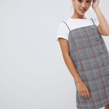 ASOS DESIGN Petite square neck mini dress with buttons in check at asos.com