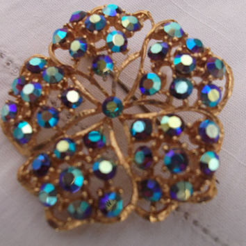 Beautiful aurora borealis and gold tone brooch. Ideal gift for , birthday, anniversary