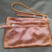 woman's brown balong leather clutch bag