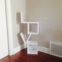 Wood LOVE shelf. Perfectly balanced to stand on the ground or hang on the wall! You can place items on it as well!