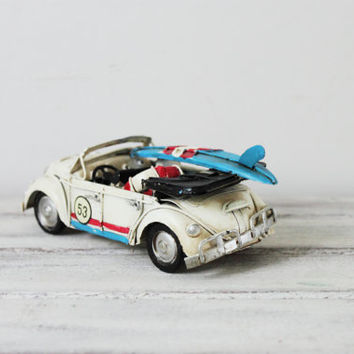 White, VW bug car miniature, convertible Beetle car with blue surfboard, shabby, retro buggy, collectible car miniature, mid nineties