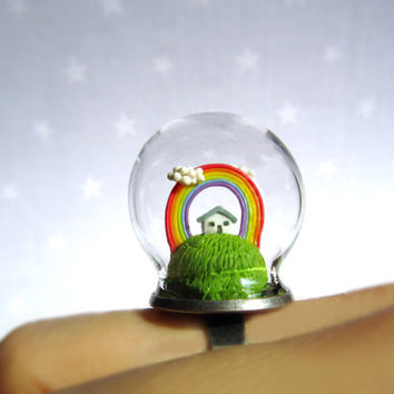 Terrarium ring with tiny house and rainbow. Miniature under glass globe.