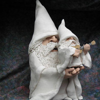 Large White Pottery Wizard holding Smaller Wizard playing guitar