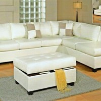 3 pc Cream bonded leather match reversible sectional sofa with free storage ottoman