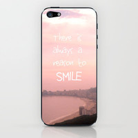 There is always a reason to smile iPhone & iPod Skin by Louise Machado