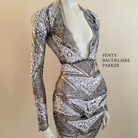 The Fenty Baudelaire Parker Titanium Mini, Sequins, Tinsel, Micro Fiber Embroidery on mesh/net. Pattern Embroidery on hem of dress and sleeves