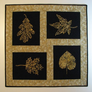 Quilted Table Topper, Black and Gold Batik Leaf Wall Hanging, Modern Quilt, Quiltsy Handmade