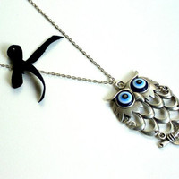 Silver plated resin blue eyed owl