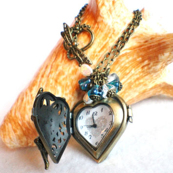 Fairy on heart watch pendant, bronze watch locket with fairy on front cover with blue and bronze accents
