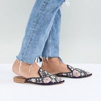 Accessorize Lonnae embroidered flat mules at asos.com