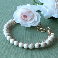 Beaded bracelet -  Ivory beads wire wrapped in gold brass