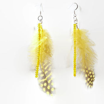 Dangle earrings with feather. Yellow feathers.  Nickel free hooks. Yellow seed beads