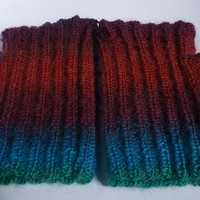 Hand knitted reversible wrist warmers.