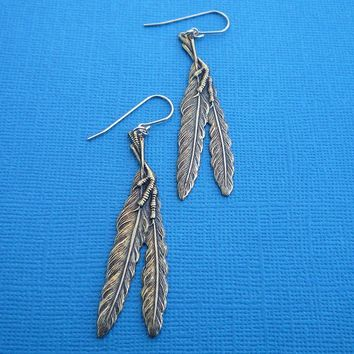 golden claw and feather earrings