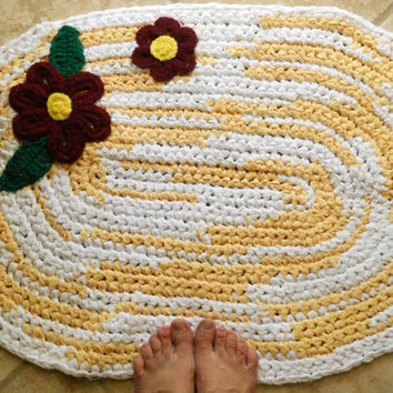 Oval Sunshine and Gerber daisies. Crocheted rag rug.