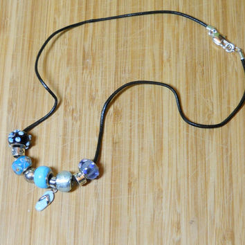 Blue Necklace Handmade in the USA, Flipflops Blue Dione-style beads black leather cord, silvertone chain, Lobster clasp, Sanibel Island