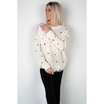 Ivory and Navy Star Distressed Sweater