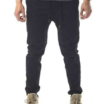 The James Tapered Ankle Zip Pants in Black