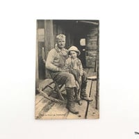 Vintage Postcard  Tadousac Quebec Canada antique post card father and son rocking chair