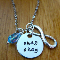 """The Fault in our Stars Inspired """"Okay"""" Necklace. Hazel and Augustus Infinity symbol. Silver colored with a Swarovski crystal."""