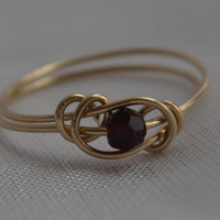 Garnet love knot ring 14 Karat gold filled wire with Swarovski crystal January birthstone Jewelry made to order
