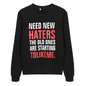 'Need New Haters' sweater