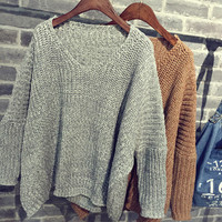 Big long loose knit female type of sweater