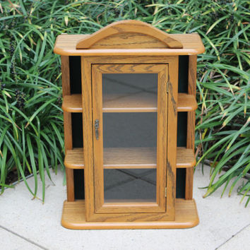 Vintage wood curio display cabinet