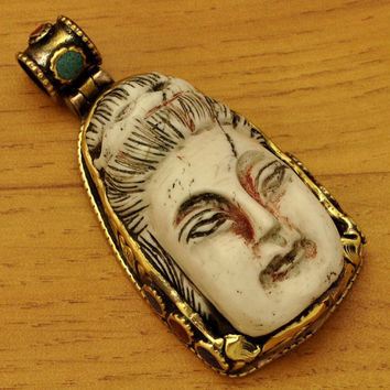 SALE Nepalese  Handcrafted and carved Brass Repousse Bone,Coral,Turquoise Kuan Yin Focal Bead