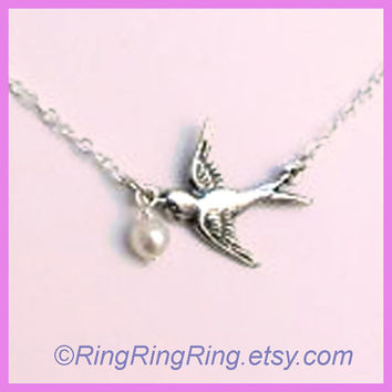 teeny tiny swallow bird necklace with Freshwater by RingRingRing