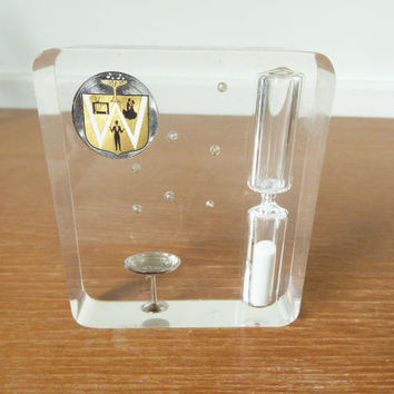 Vintage acrylic sand timer with floating champagne bubbles and champagne glass