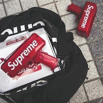 Supreme SS17 Red Box Logo Cash Cannon Money Gun