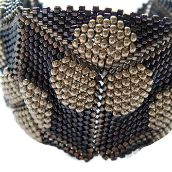 Black and silver beaded cuff bracelet. Geometric triangle beadwoven bracelet.