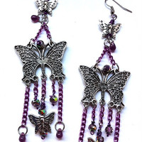Long butterfly dangle earrings with purple chains,