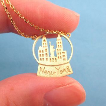 New York Skyline Snow Globe Pendant Necklace in Gold | DOTOLY