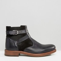 ASOS Chelsea Boots In Black Leather With Faux Shearling Lining at asos.com
