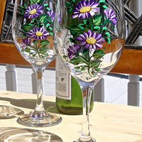 Hand Painted Wine Glasses With Purple and White Flowers and A Wine Glass Charm