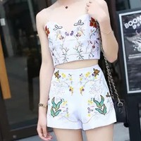 White V-neck Embroidery Floral Cut Out Strap Crop Top And Shorts