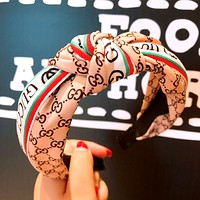 GUCCI tide brand female section letter knotted ribbon changeable hairpin hairpin Apricot