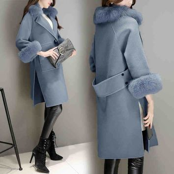 Women Korean version of the temperament of the big hair collar Mao Mao jacket female cocoon fashion spring and autumn woolen