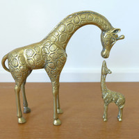 Brass giraffes, adult and baby giraffe