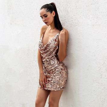 """""""Always on time"""" gold sequined halter mini dress"""