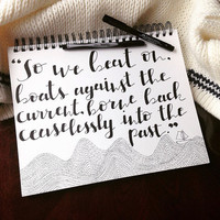 """Quote from The Great Gatsby: """"So we beat on, boats against the current, borne back ceaselessly into the past,"""" in Black Calligraphy"""