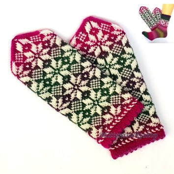 Hand knitted mittens Gloves from wool and batic yarn White star ornament on a pink green dark purple background Patterned latvian mittens