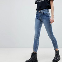 River Island Amelie Twisted Seam Skinny Jeans at asos.com