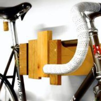 Supermarket - wall mounted bike rack - reclaimed wood from cantilever and press