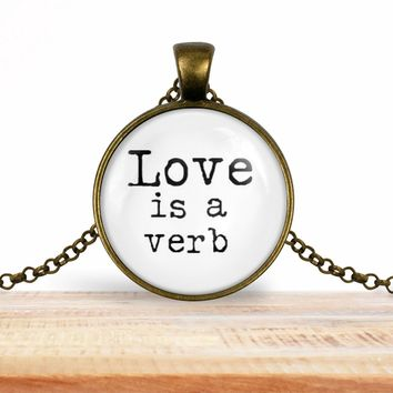 "Valentine's Day quote pendant necklace ""Love is a verb"", choice of silver or bronze, key ring option"