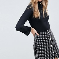 ASOS Spot Mini Skirt with Faux Pearl Buttons at asos.com
