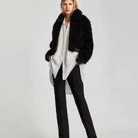 JACKET WITH CONTRASTING TEXTURE DETAILS