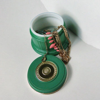 Vintage vanity piece. Avon regence perfumed skin softener in green jar with gold accents. Ring jar, jewelery box.